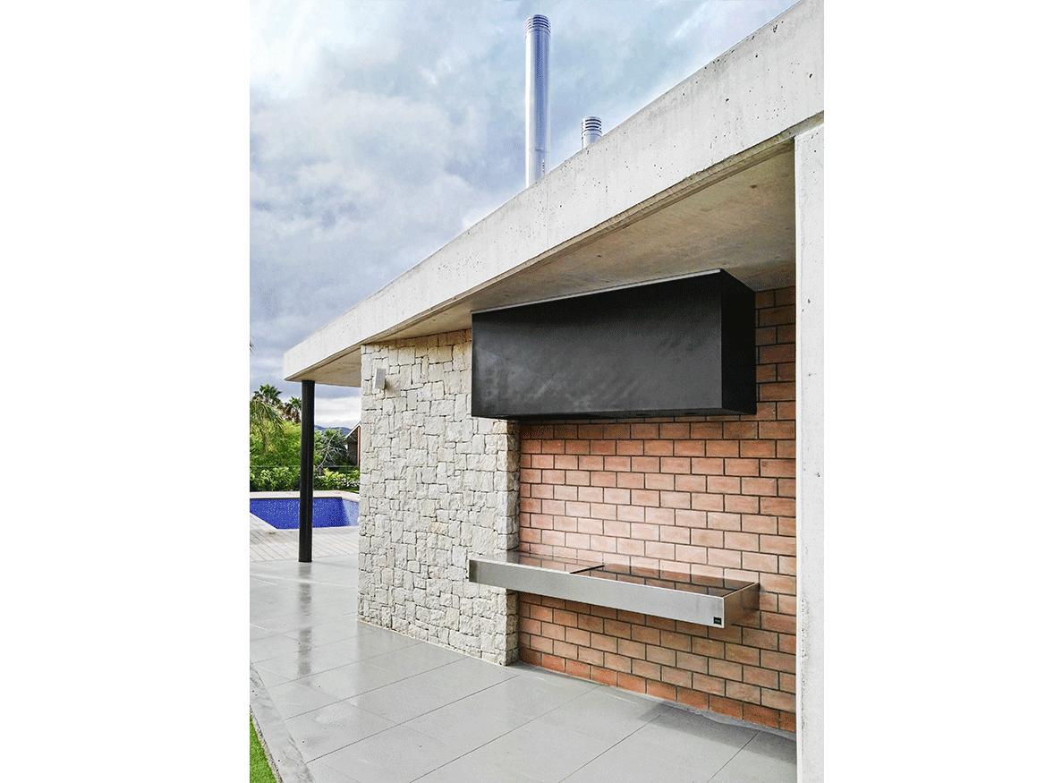 construcción de vivienda en hormigón visto y piedra elo construcciones barbacoa
